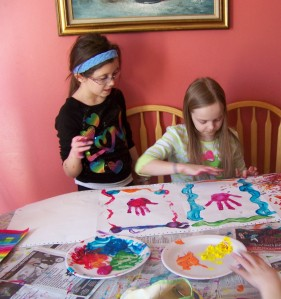 Let's finger-paint some more!  Best friend hand prints!