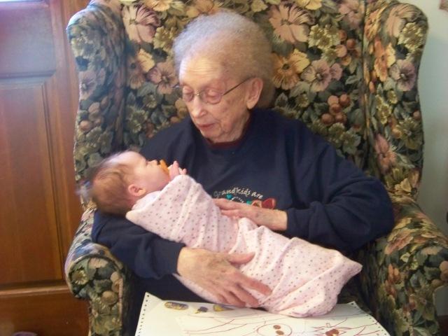 My Grandma holding a baby that I babysit.