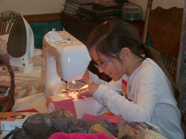Kaylin sewing for the first time!