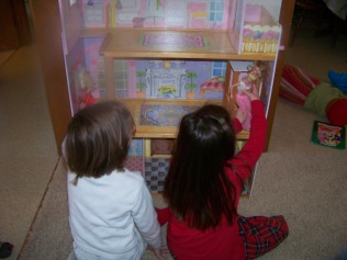 Kaylin and Karis playing with their new house Chrismas morning, 2011