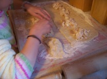 Then we brought up each end andn pinched the dough together.