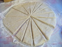 Made a circle of dough and cut them iinto triangles.