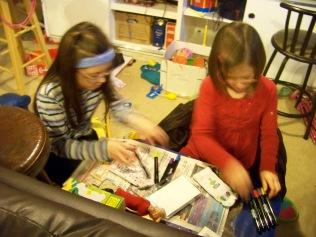 Kaylin and Karis decorating their socks.