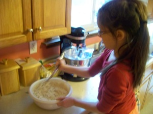 Kaylin stirring the dough.
