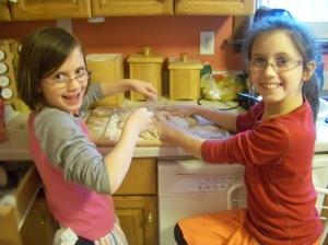 Kaylin and Karis kneading the dough.