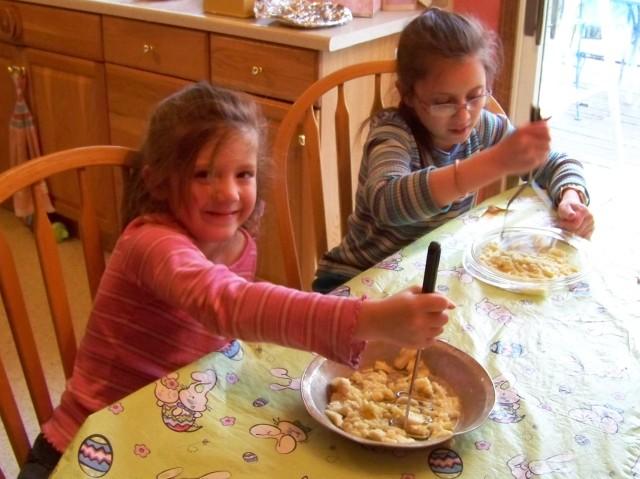 Kristi and Kaylin smashing the bananas.