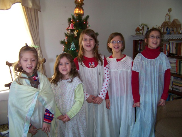 The great-grandkids wearing Great-Grandma's old clothes . . . and so happy!