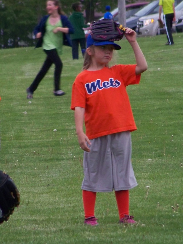 Kristi actually took off her glove and put it on her head for a minute! T-ball is such a comedy sport.