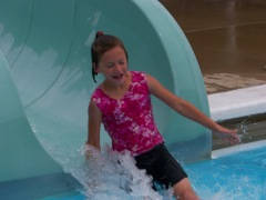 Karis going down the water slide