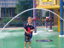Joshua playing in the splash park.